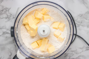 butter and flour in food processor.