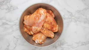 a bowl of raw chicken.