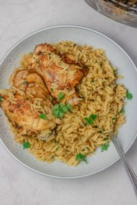 a plate of rice and chicken.