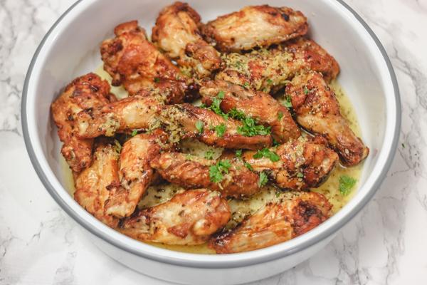 chicken wings in an enamel bowl.
