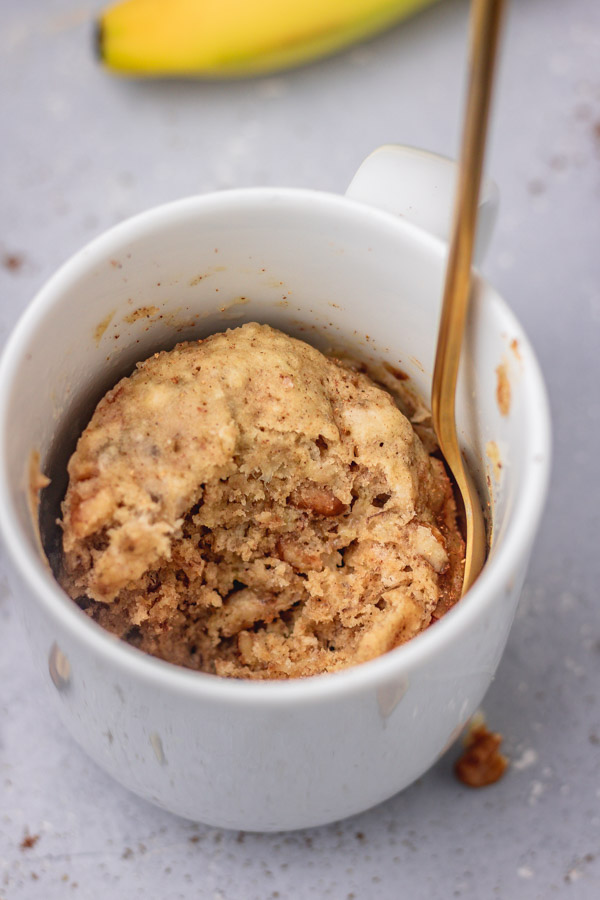 a mug of cake with some bits taken out.