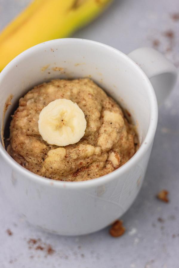 mug cake topped with a slice of banana.