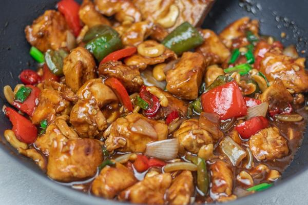 stir fry in a wok.