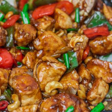 chicken stir fry in a wok.