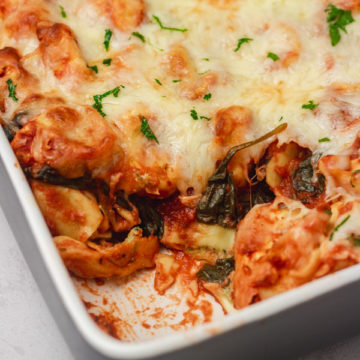 baked tortellini in a baking dish.