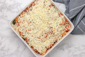 pasta covered with cheese in a baking dish.