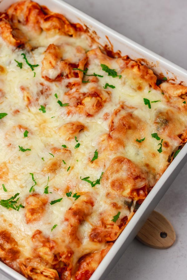 baked cheesy pasta in a baking dish.
