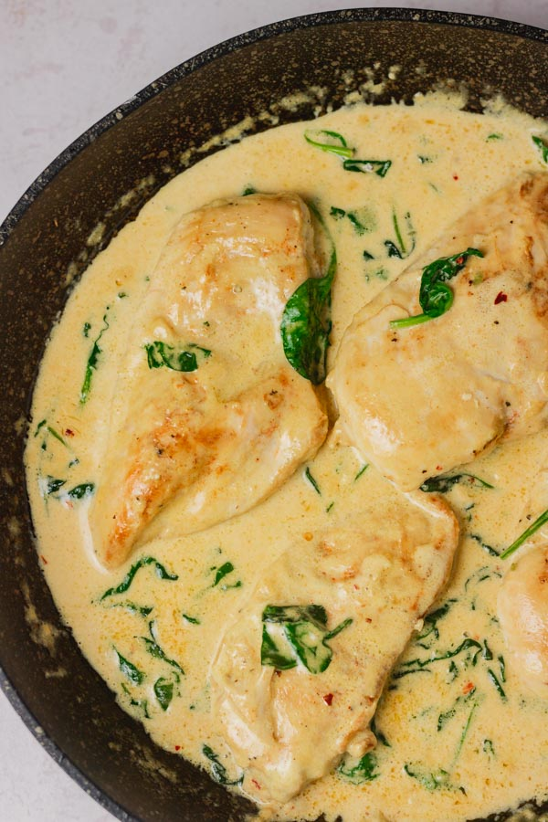 creamy sauce with spinach and chicken breast.