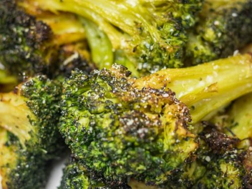 a plate of roasted broccoli.
