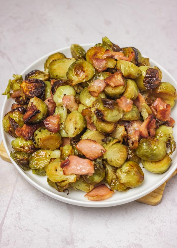 brussels sprouts and bacon on a side plate.