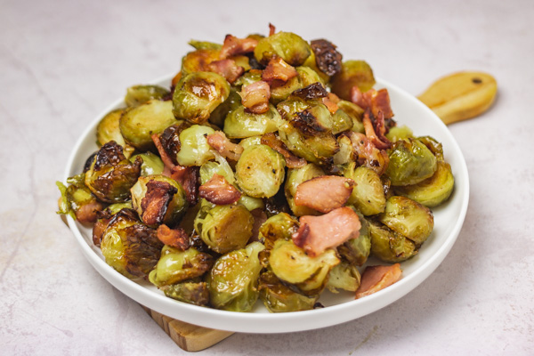 a plate of brussels sprouts and bacon.