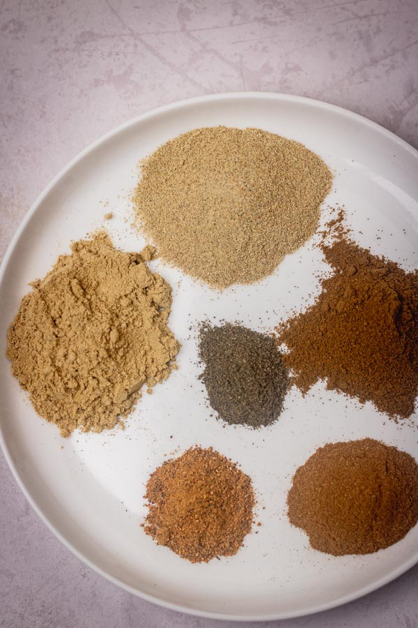 individual ground spices on a plate