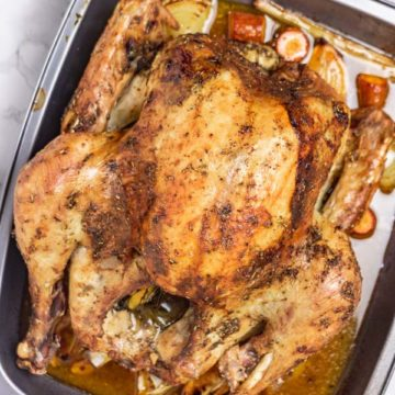 roasted turkey in a pan.