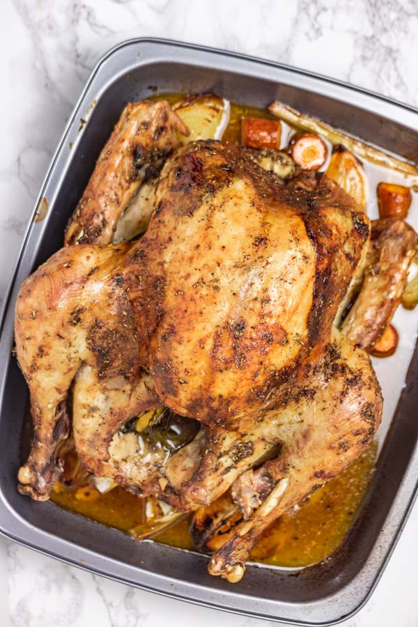 roasted turkey in a pan.