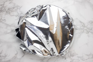 a tin foil over a baking dish.