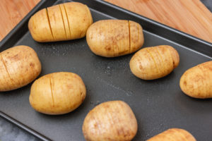 potatoes on a baking tray.