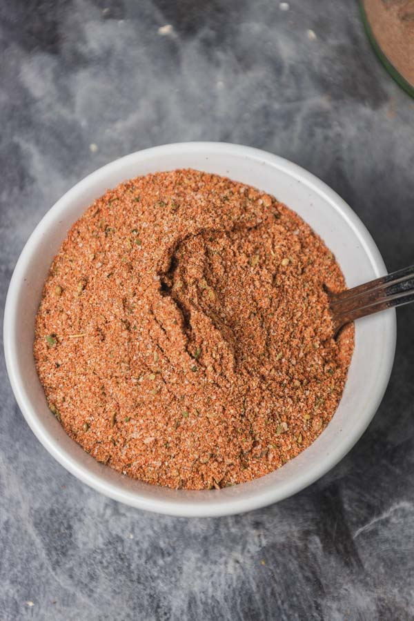 a small white bowl of spice blend.