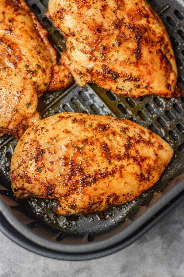 three chicken breasts in air fryer.