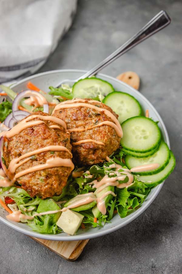 burger salad bowl with a fork.