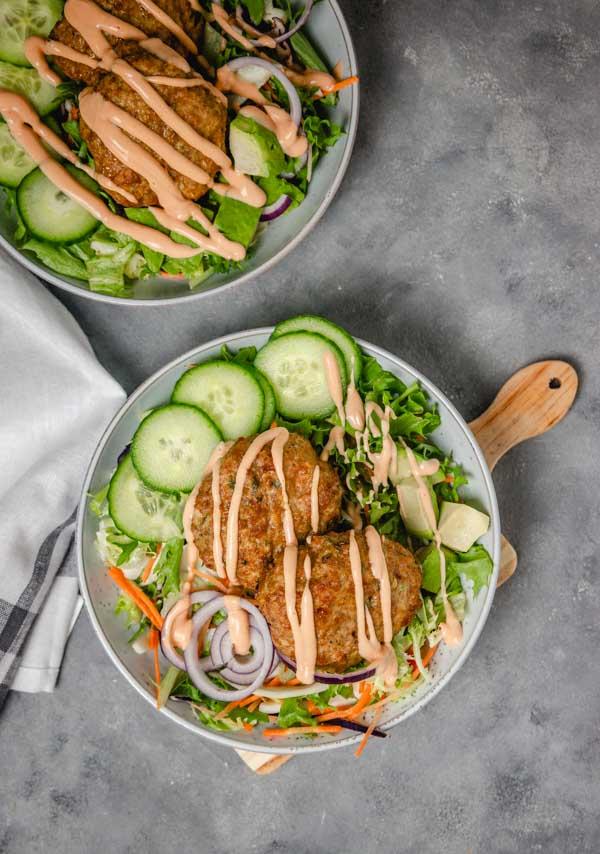 two bowls of burger salad bowls.