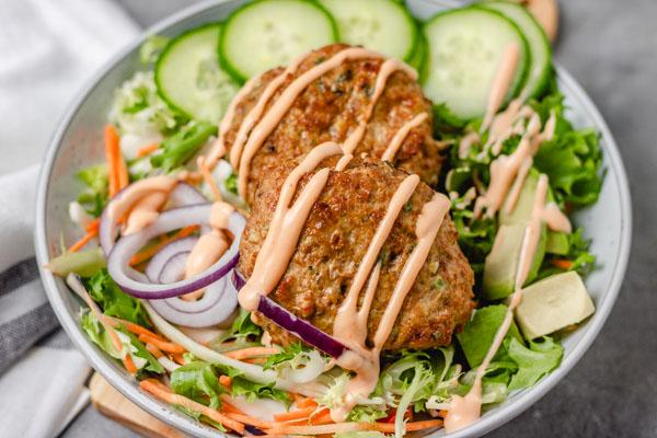 a bowl of burger and salad.