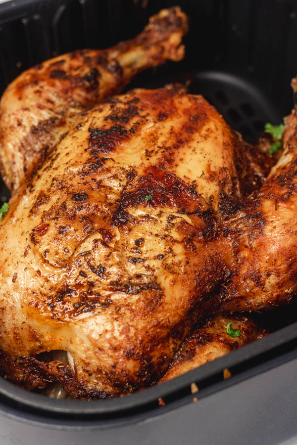 roasted whole chicken in basket.