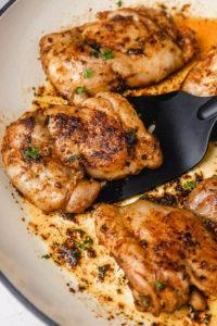 boneless chicken thighs in a skillet.