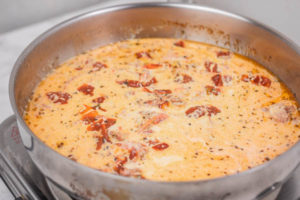 creamy sauce in a skillet.