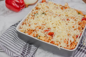 pasta topped with grated cheese in a baking dish.