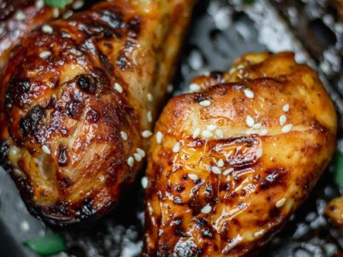 chicken legs in air fryer basket.