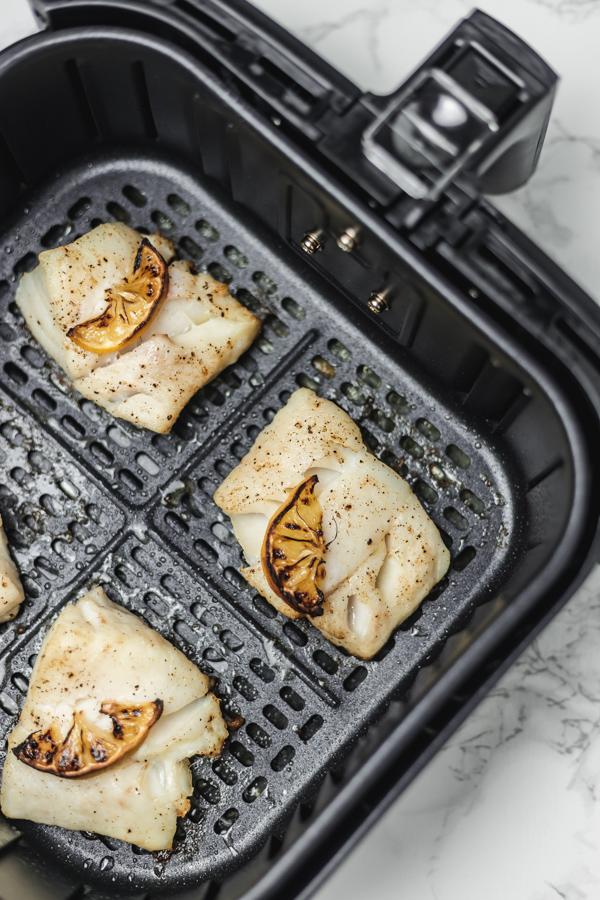 cod fillets in air fryer basket.