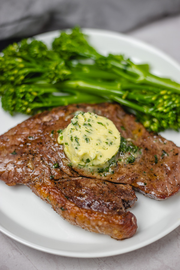 steak topped with herb butter.