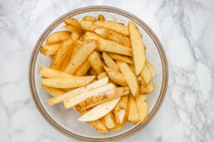 sliced potatoes in a bowl.