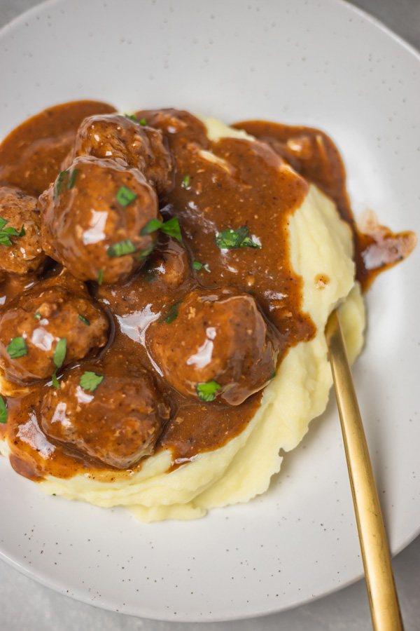 meatballs and gravy over mashed potato.
