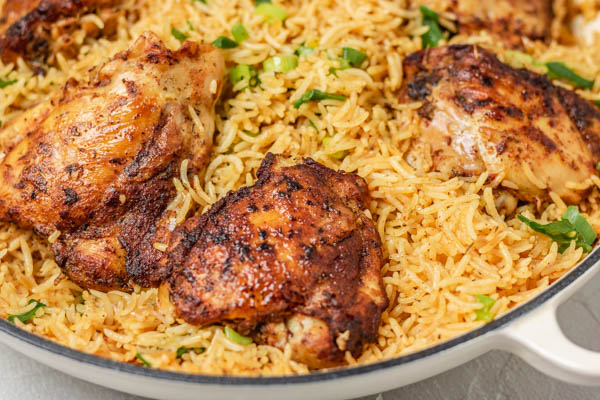 rice and chicken in a skillet.