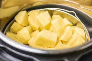 cubed potatoes in a pot.