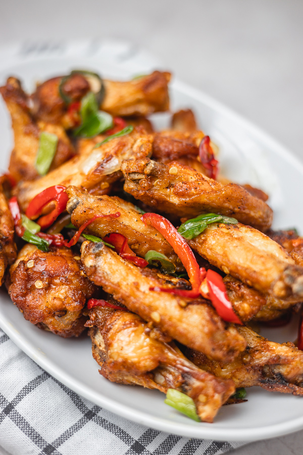 chicken wings and pepper on a plate.