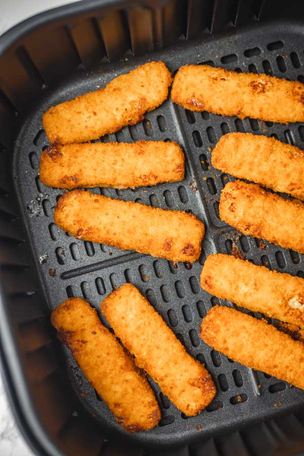 ten fish sticks in air fryer basket.