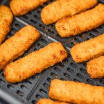 fish fingers in air fryer basket.