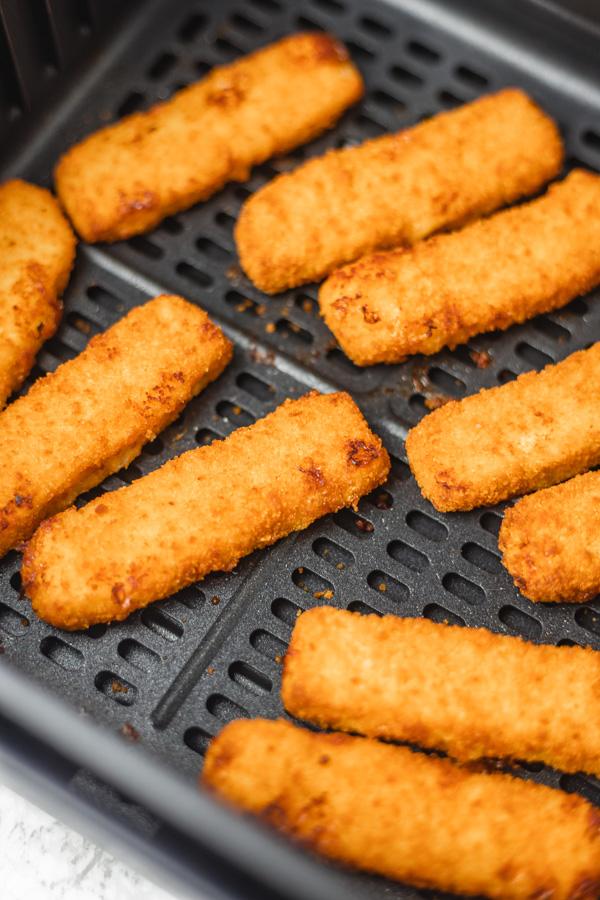 fish sticks in air fryer basket.