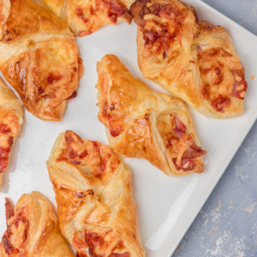 puff pastry turnovers on a white platter.