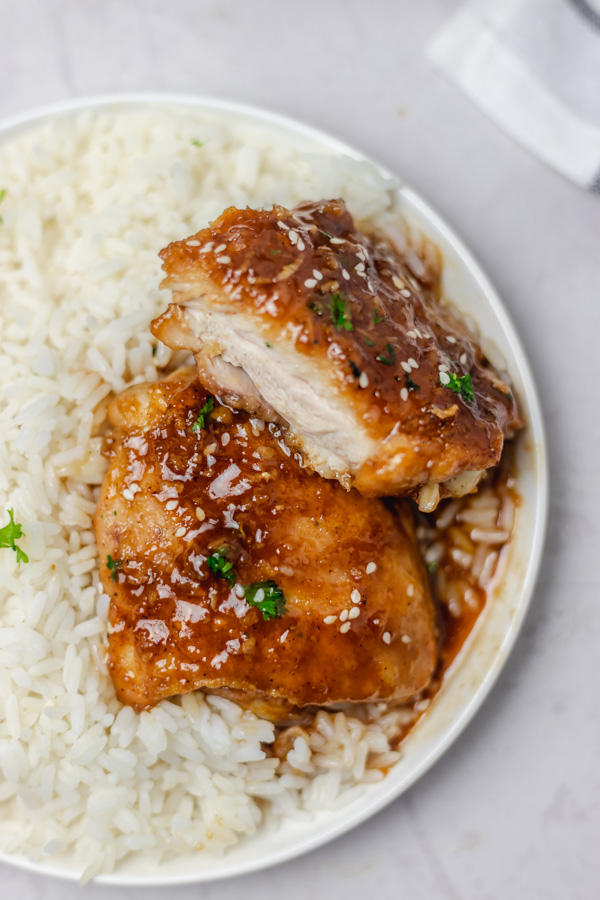 a plate of chicken and rice.