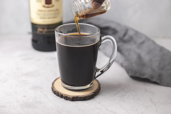 pouring liquid into coffee.