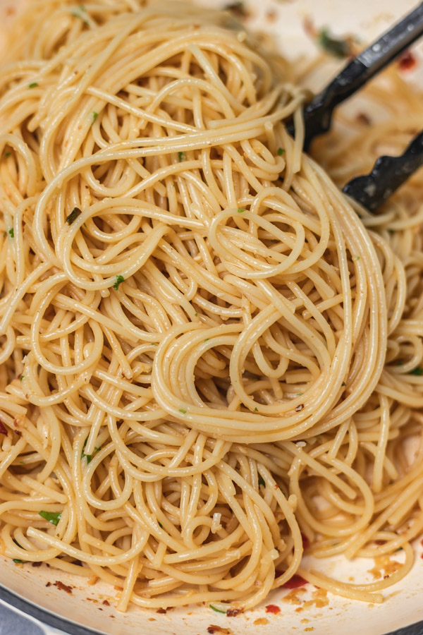 a close up on spaghetti in a pan.