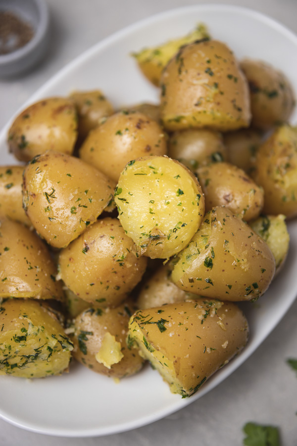a close up of baby potato side dish on a plate.