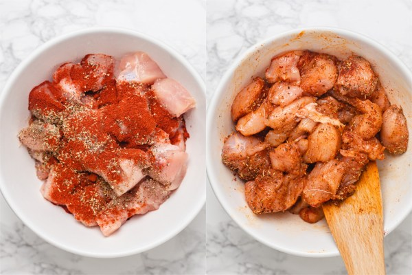 the process shot of seasoning cubed chicken pieces in a bowl.