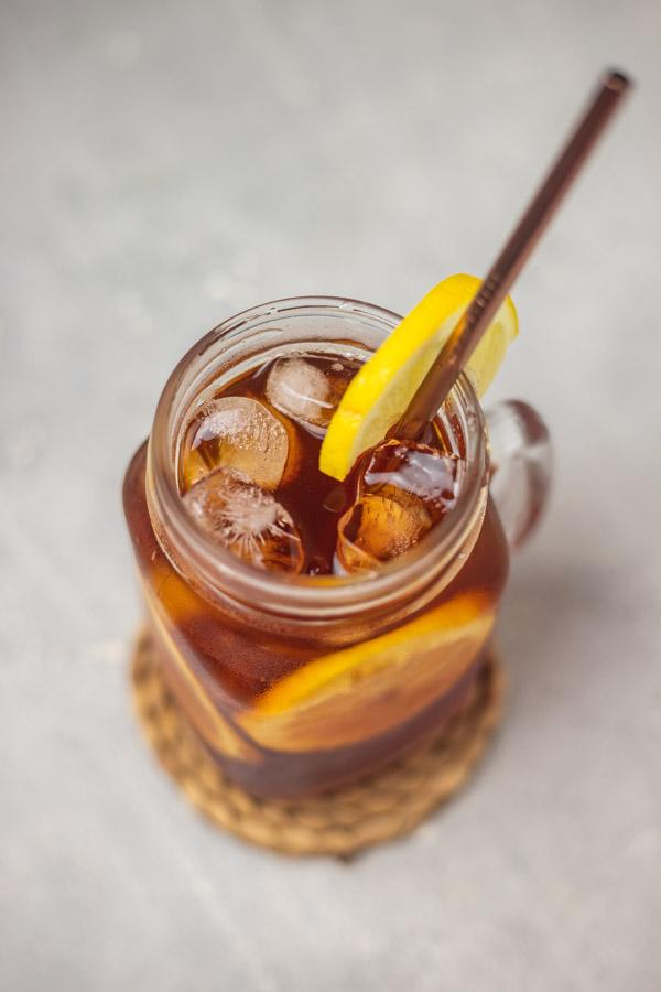 the overhead shot of lemon iced tea in a mason jar glass.
