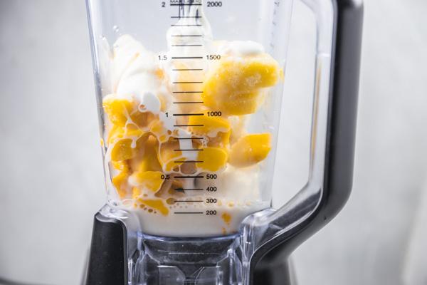 mango chunks, pineapple chunks and milk in a blender.