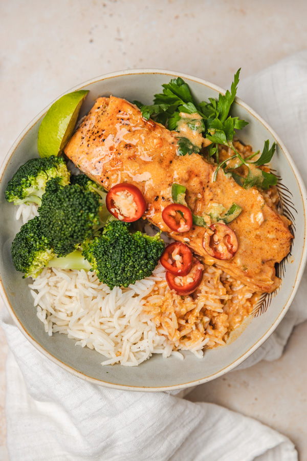 the overhead shot of a salmon curry bowl.