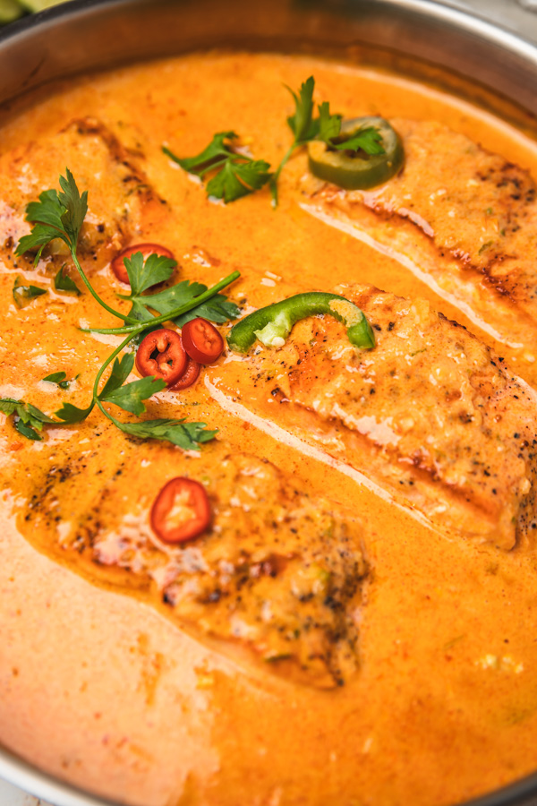 a close shot of a pan of salmon curry.